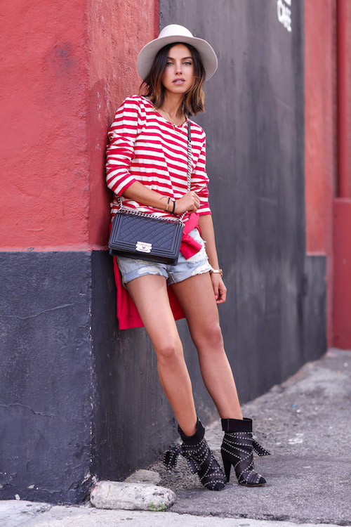 1.-striped-top-with-denim-shorts-and-edgy-boots